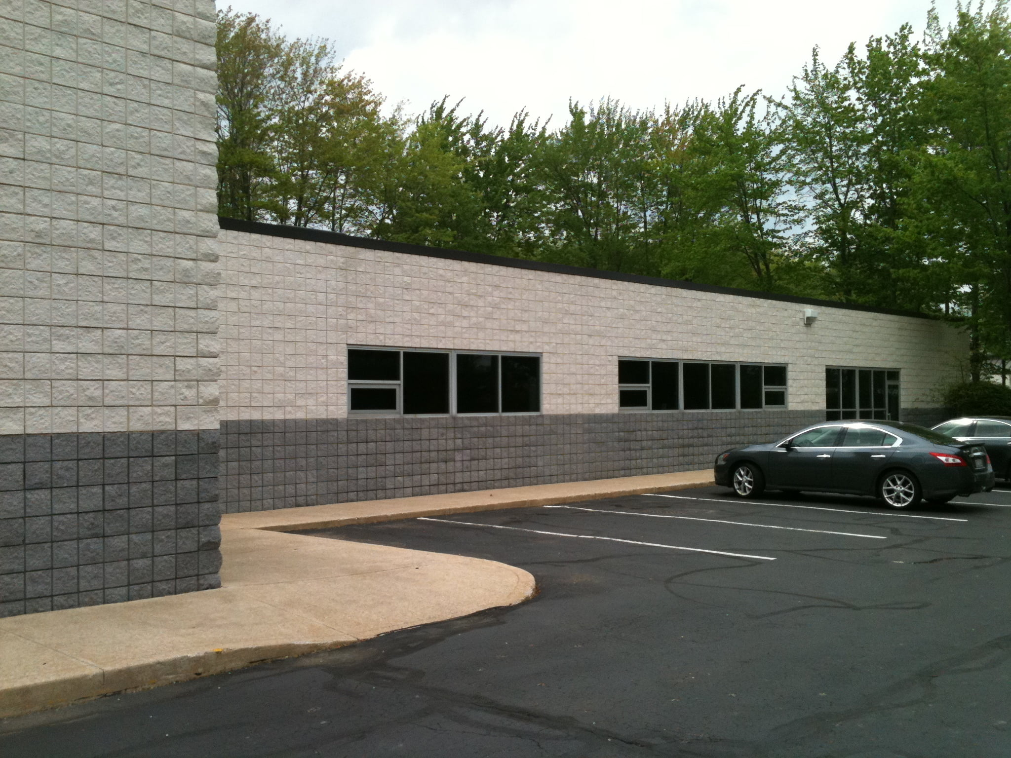 Side Of Commercial Building After Industrial Cleaning And Commercial Painting